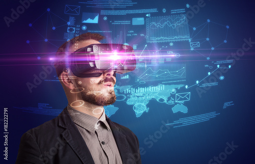 Businessman with virtual reality goggles