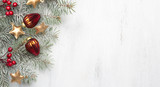 Christmas decorations and fir tree on white shabby wooden background. - 182227302