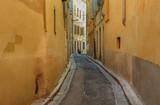 A narrow street in the European city.