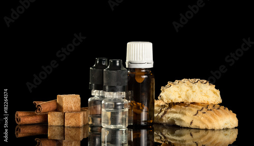 The bottle of liquid for Smoking, candy and cookies, isolated on black