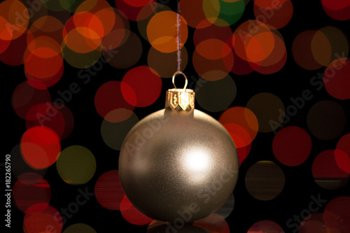 Beautiful silver Christmas ball on dark background