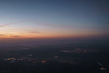 sunrise over city during flight on a plane - 182266747