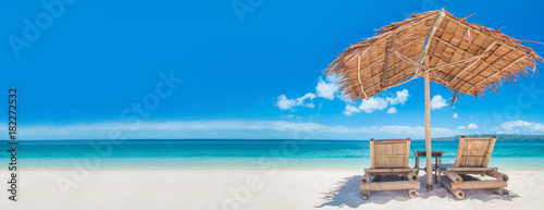 Foto op Canvas Tropical strand Chaise lounges on beach