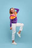 Happy woman in bright clothes - 182272763