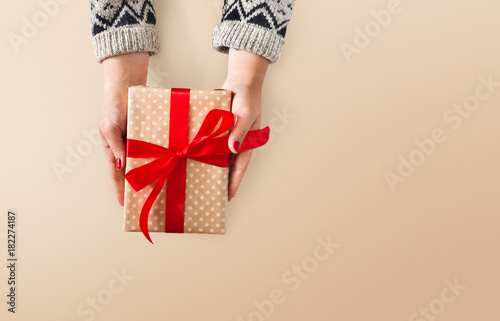 Poster Woman's hands give christmas gift in present box