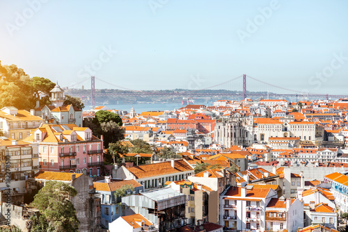 Cityscape view on the Lisbon city with famous bridge during the sunny day in Portugal