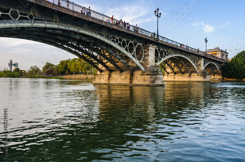 Naklejka Triana Bridge in Seville, Spain