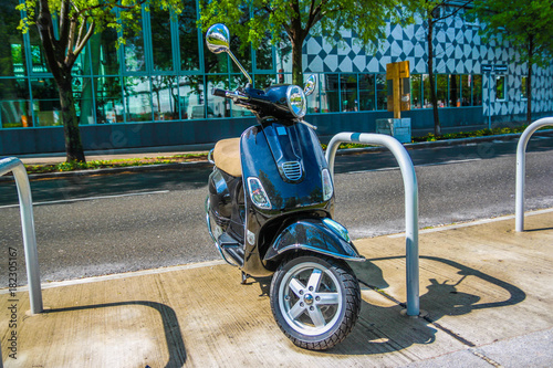 Plexiglas Scooter Scooter parked on street