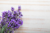 Bouquet of summer lavender on an old wooden background (top view)