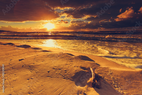 Fotobehang Strand Beatiful sunset with clouds over sea and beach