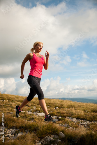 Staande foto Jogging runner - woman runs cros country on a path in early autumn