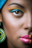 close up of black African woman face with golden and blue makeup - 182321311