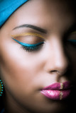 close up of black African woman face with golden and blue makeup - 182321387