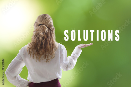 Fridge magnet young woman holding the concept of solutions