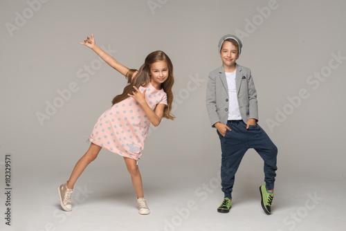 Happy dancing kids. Studio photo. - 182329571