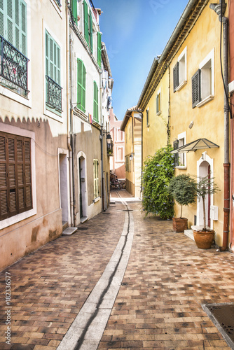 Tuinposter Smal steegje Colorful, narrow street of homes in Europe