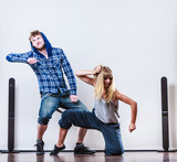 couple of young man and woman dancing hip-hop - 182348723