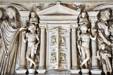 Bas-relief and sculpture details in stone of Roman Gods and Emperors - 182380594