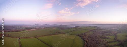 Fotobehang Purper Dawn panorama over rural english countryside