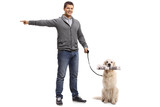 Young man pointing with his hand and a labrador retriever dog with a newspaper - 182394172