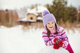 child building a snowman - 182394365