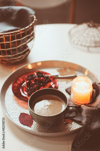 Cozy winter weekend at home. Morning with coffee or cocoa, berry pie and candle lights. Hygge concept.