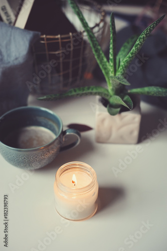 cozy winter morning at home. Hot cocoa or coffee with candle and succulent on white table