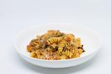 Pasta Sweet Tomato, Aubergine and Ricotta. White background. White plate. Isolated. - 182399502