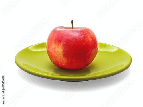 Poster Red apple on green plate, healthy food
