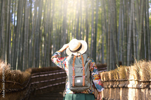 Sticker Tourist is walking through Bamboo forest inside Adashino Nenbutsuji temple in Arashiyama, Kyoto, Japan.
