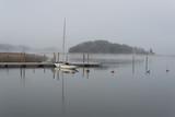 Sailboat in morning mist - 182407136