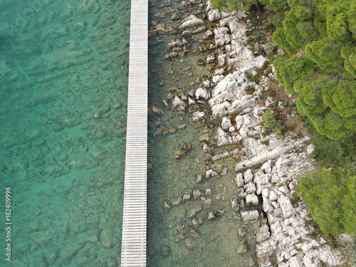 aerial view of a jetty on rocky beach