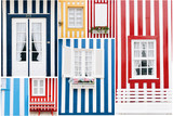Diversity of the beautiful striped colorful house facades with windows and doors