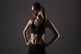 Portrait of a confident young asian fitness woman - 182412504