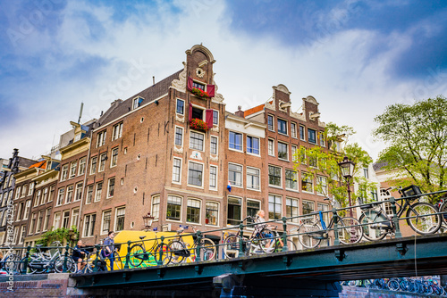 Foto op Canvas Amsterdam Amsterdam, the Netherlands, September 5, 2017 : Amsterdam Netherlands dancing houses over river Amstel