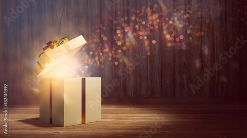 Geschenk leuchtet als Überraschung zu Weihnachten - 182414392