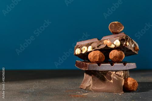 Close up dark chocolate stack on blue background