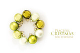 Green Christmas balls in a circle isolated with shadows on a white background, text Peaceful Christmas for everyone, flat top view from above, copy space - 182422143