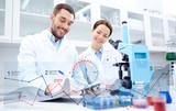 scientists with microscope making research in lab - 182422779