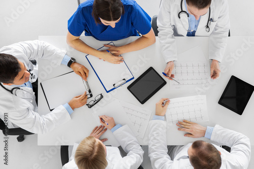 group of doctors with cardiograms at hospital