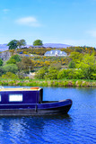 Forth and Clyde Canal with long boats in Scotland, UK - 182426935