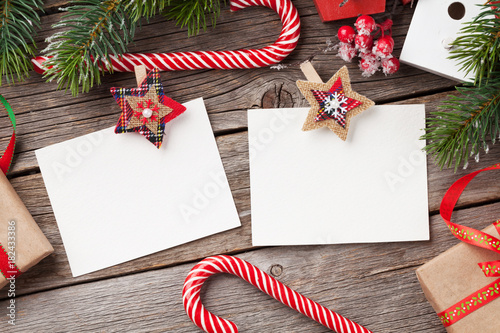 Fototapeta Christmas blank photo frames, decor and fir tree