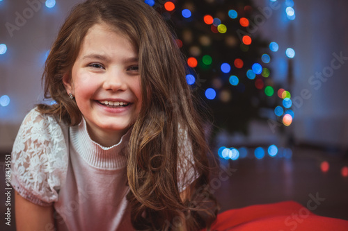 Portrait of a happy child on the background of a Christmas tree