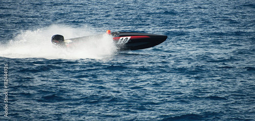 Speed boat cruising in the ocean,boat race