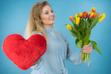 Woman holds tulips and red heart - 182448558