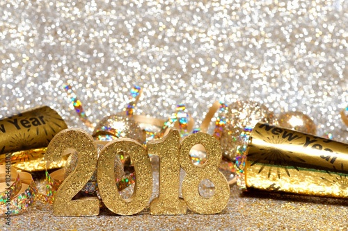 New Years Eve 2018 golden numbers and decorations with twinkling light background