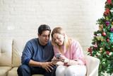 Using a smartphone on Christmas - 182456382