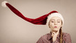 Funny girl wearing blowing santa claus hat