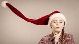 Funny girl wearing blowing santa claus hat - 182461913