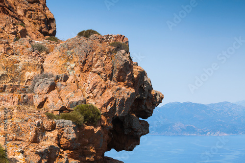 Face shaped coastal rocks of Corsica island